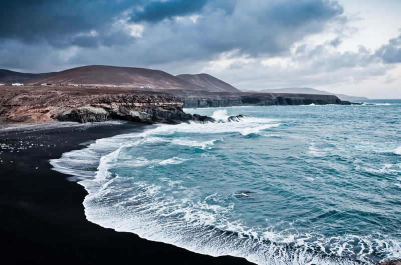 Black beach in Ajuy, Fuerteventura, 2017 Fuerteventura Beachphotography Beauty In Nature Blackbeach Cloud - Sky Day Mountain Nature No People Outdoors Scenics Sea Sky Tranquil Scene Tranquility Water Waterfront Wave