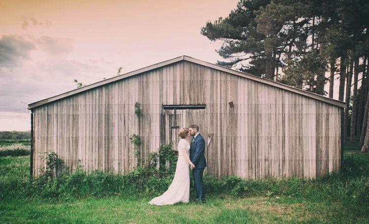 Wedding Photography Wedding Kiss Brideandgroom Barn United Kingdom Rustic Weddings Around The World