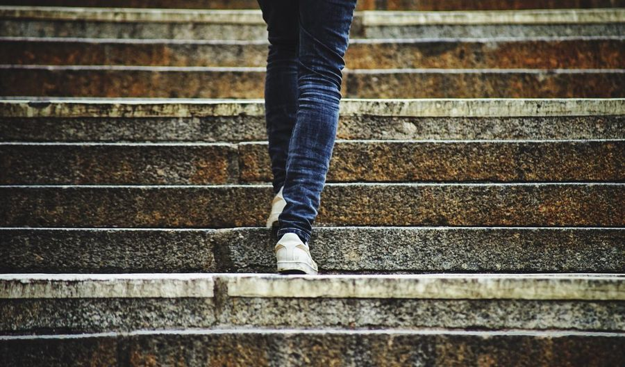 Low section of man on stairs