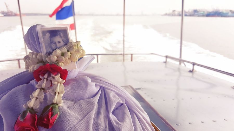 Last Goodbye ,Grandma : Scattering ashes over water (Estu ary) Flag Day No People Outdoors Hanging Nautical Vessel Sea Close-up Water Burial Long Goodbye Grandmother Ashes Love♥ Beauty In Nature Backtonature Backtohome Family Sea And Sky ลอยอังคาร
