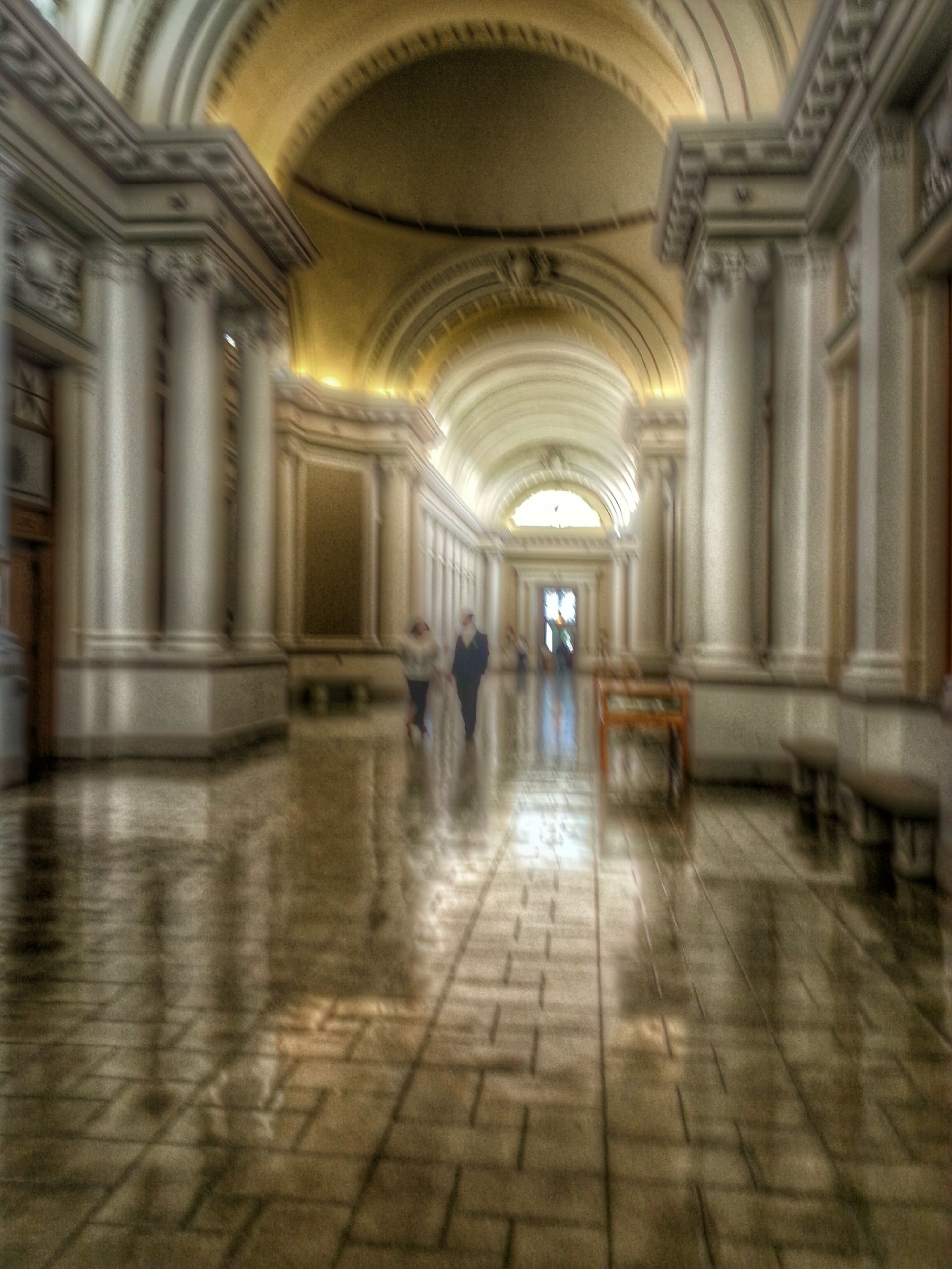 indoors, arch, corridor, architecture, flooring, ceiling, built structure, architectural column, tiled floor, interior, religion, the way forward, place of worship, church, spirituality, person, diminishing perspective, men