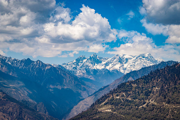 Himalaya mountain valley with bright blue sky at day from hilltop