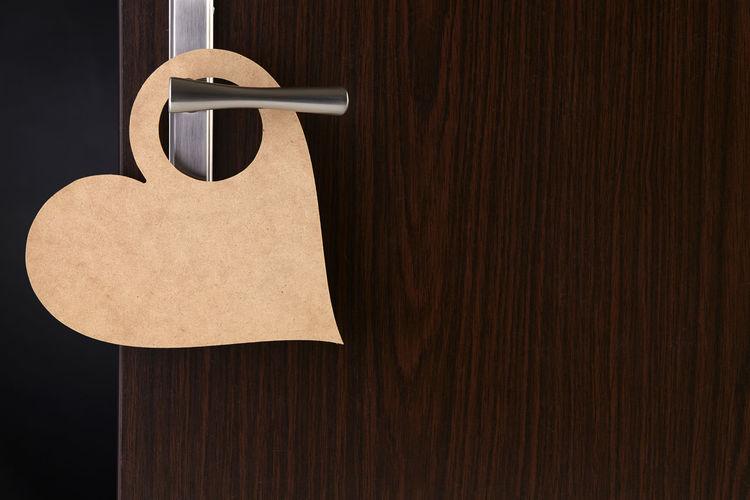 Close-up of paper hanging on wooden door