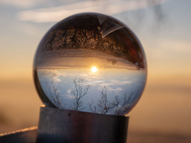 Sphere Sky Reflection Sunset Transparent Nature Close-up Glass - Material Crystal Ball No People Focus On Foreground Scenics - Nature Outdoors Ball Landscape Beauty In Nature Upside Down Day Crystal Land Glass