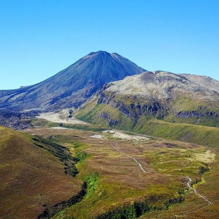 Volcano in New Zealand Mountain Scenics Tranquil Scene Beauty In Nature Nature Tranquility Landscape No People Outdoors Volcano Clear Sky Idyllic Day Volcanic Landscape Blue Sky Drone  Dronephotography Droneshot Drone Moments Drone Photography Drones EyEmNewHere