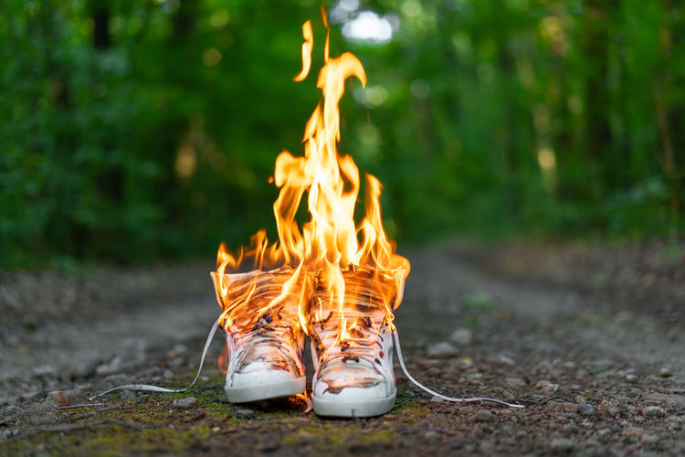 Shoes burning in forest