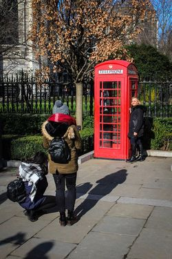 Full Length Telephone Telephone Booth Tree Communication Outdoors Women Pay Phone City Cultures People Day Adult Young Adult Adults Only St Paul's Cathedral London Photographer Posing London Lifestyle Everyday Lives Tourist Places Of Worship Red Telephone Box Architecture