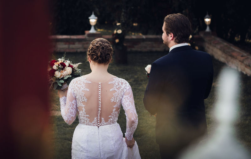 freshly married young couple walking away from camera Rear View Two People Love Men Bride Togetherness Adult Wedding Dress Standing Wedding Newlywed Women Event Celebration Waist Up Emotion Couple - Relationship Positive Emotion Well-dressed Formalwear Wedding Walking
