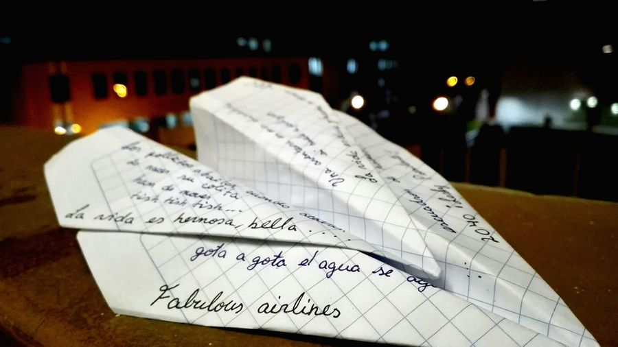 Text on paper plane