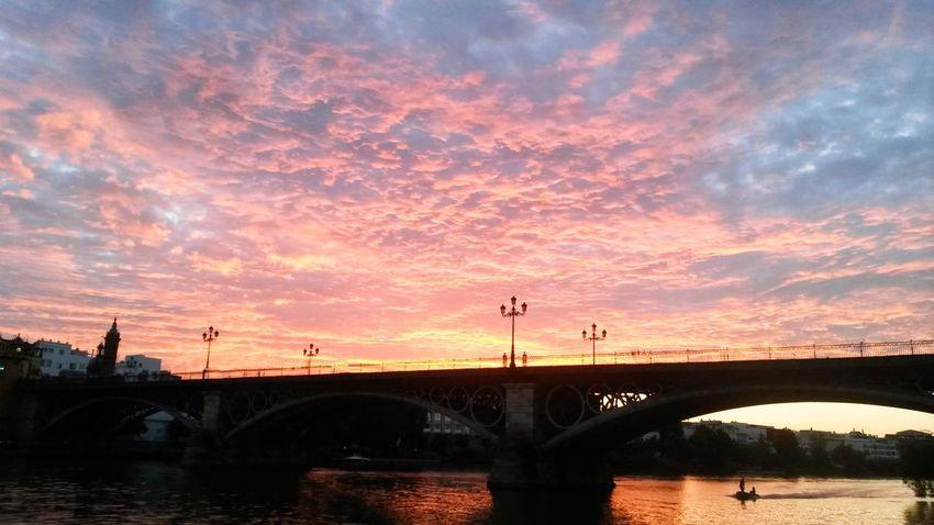 Cities_collection River View Sunset Puente Puesta De Sol Sevilla Clouds And Sky Shillouettes And Sunshine Landscapes Guadalquivir Bridgesaroundtheworld Bridge View Puentedetriana