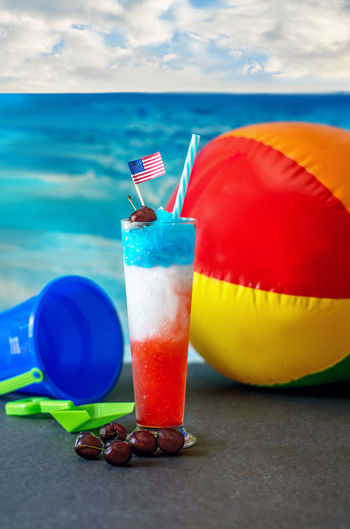 a refreshing frozen drink for your 4th of July beach party. frozen spiked lemonade with vodka and natural fruit. or make non alcoholic for the kids American Flag Fresh Fruit Garnish Decoration Alcoholic Beverages Alcoholic Drink Adult Beverage Mixed Drink Red White Blue Fun Frozen Cold Icy Chilled Summertime Beach Drinks Traveling Beach Toys Refreshing :) Fruity Slush Holiday Vodka