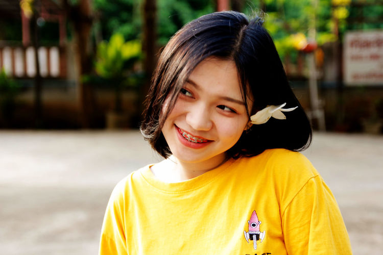 Asian girl is smiling cute Casual Clothing Child Childhood Emotion Females Focus On Foreground Front View Girls Hairstyle Happiness Headshot Innocence Looking At Camera One Person Smiling Teeth Toothy Smile Women