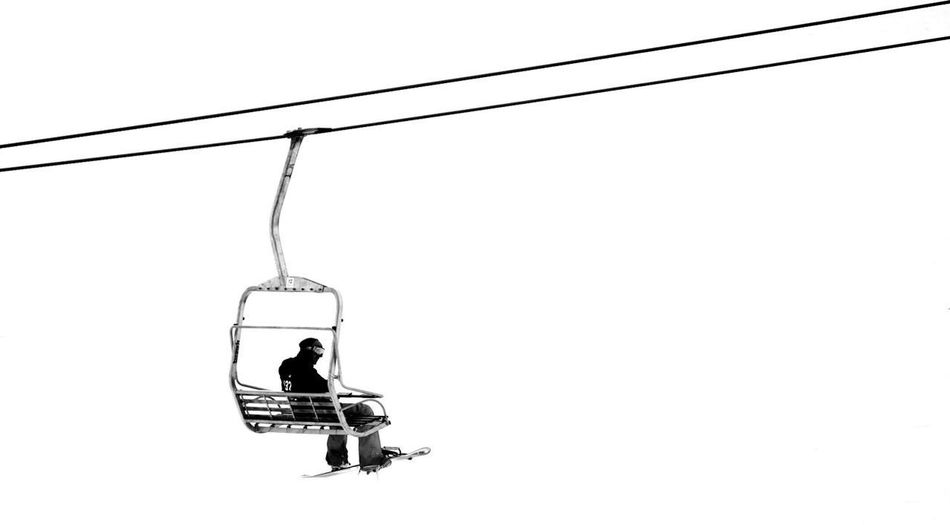 Silhouette of ski lift against clear sky