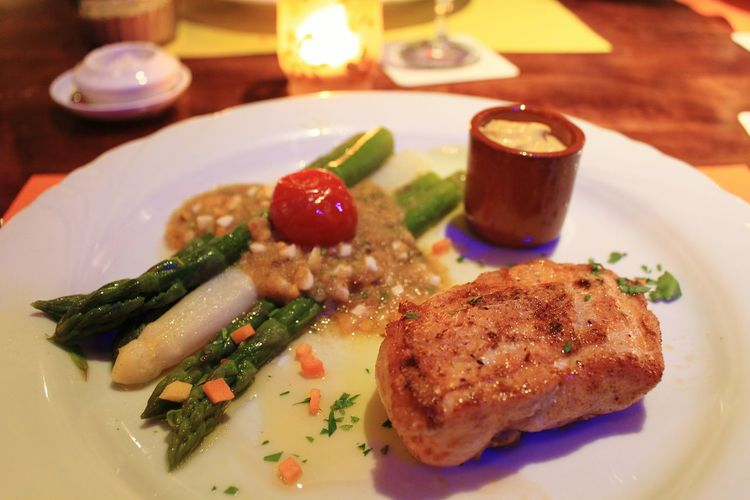 Tbt europe trip... this wonderful fish steak that i had in interlaken... Food Foodphotography Fish Steak Closeup Shot Asparagus Mini Tomatoes Restaurant Interlaken Swiss Food Nice Plating Delicious Food Dining In Nice Ambience