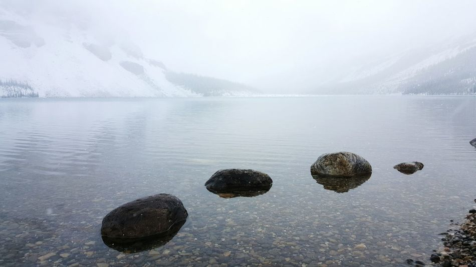Water Tranquil Scene Scenics Beauty In Nature Tranquility Lake Mountain Nature Non-urban Scene Majestic Waterfront Calm Surface Level Mountain Range Day Purity Foggy No People Remote