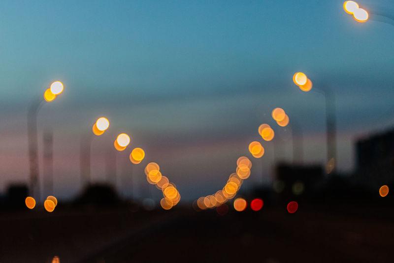 Defocused image of illuminated street lights at night