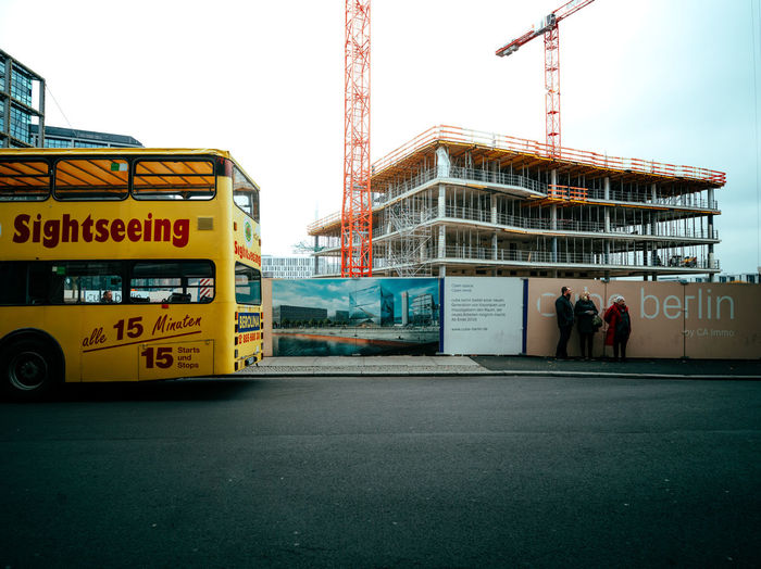 Low angle view of yellow construction site against clear sky
