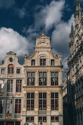 Low angle view of historic buildings against cloudy sky