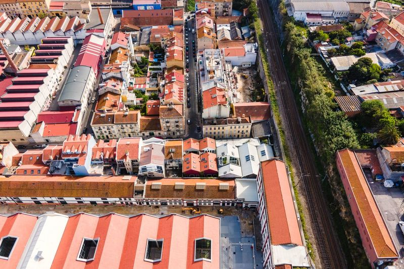 Aerial view of a small residential district in lisbon outskirt along a railway, lisbon, portugal.