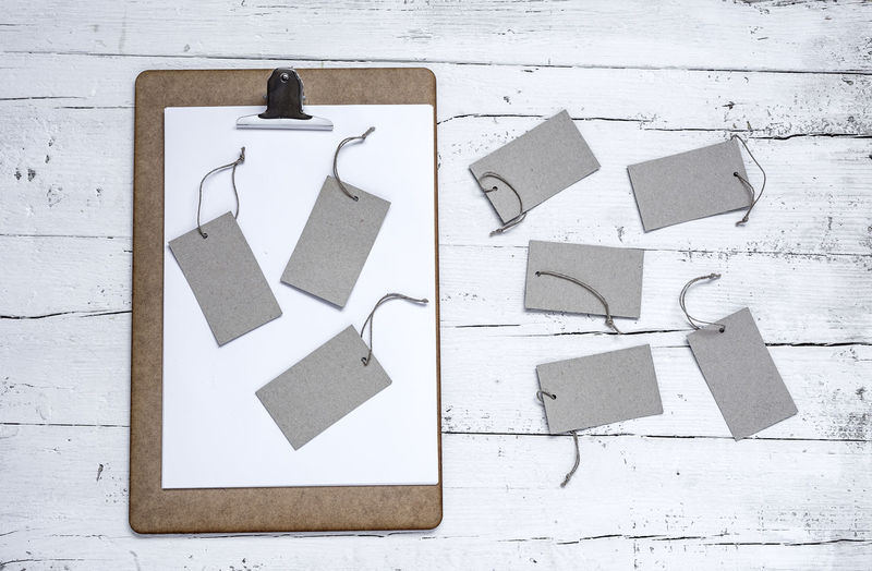 Arrow Symbol Communication Creativity Day Direction Directly Above Guidance High Angle View No People Outdoors Paper Representation Sign Still Life Symbol Text White White Color Wood - Material