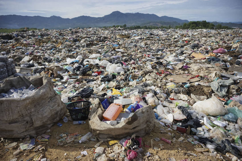 KOTA KINABALU, MALAYSIA - 09 JULY, 2017: The view of landfill site at Kayu Madang, Kota Kinabalu, Sabah.Malaysia. DUMPING SITE Kota Kinabalu Landfill Poor  Recycle Rubbish Sabah Borneo Sabah Malaysia Unused Waste
