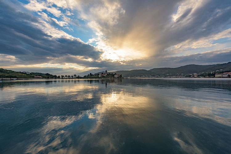 The sky explodes into morning over the town of Vis, on the beautiful small island with the same name. Adriatic Beauty In Nature Coast Croatia Idyllic Landscape Morning Nature Nature Nature's Diversities No People Non-urban Scene Outdoors Reflection Scenics Sky Sun Sunrise The Great Outdoors - 2016 EyeEm Awards Tourism Tranquility Travel Destinations Water Www.benjaminvanderspek.com