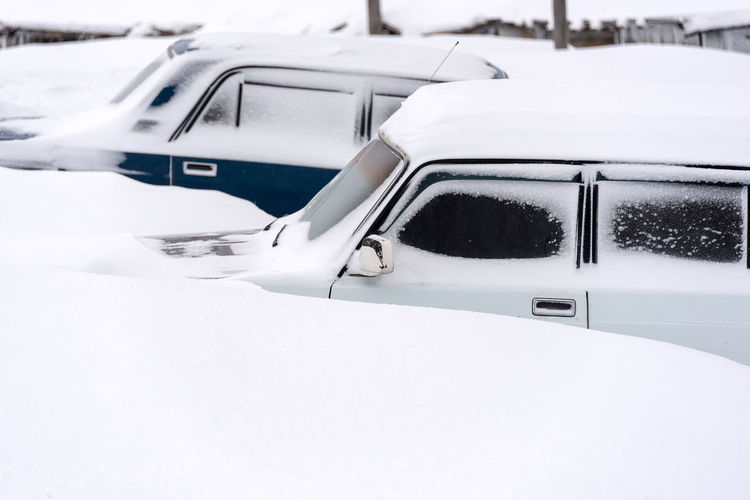 White car on snow covered field