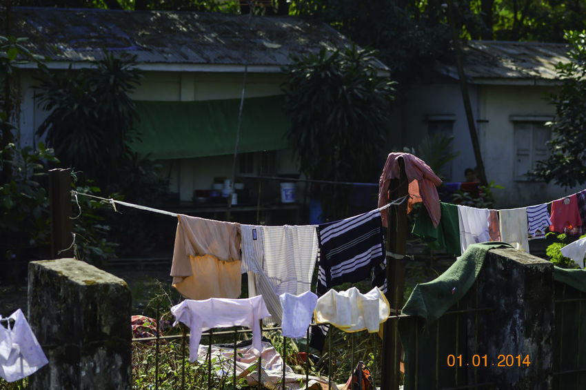 A clothing line strung up in the backyard along the circular train around Yangon, Myanmar. Colorful Clothing Colors Yangon Yangon Circular Train Yangon Circular Railway Yangon, Myanmar Building Exterior Clothesline Clothing Drying Clothing Hung Out To Dry Day Food Freshness Market Myanmar No People Outdoors Retail  Yangonlife