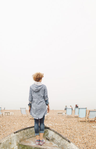 Beach Beauty In Nature Blonde Brighton Brighton Pier Casual Clothing Clear Sky Curly Hair Day Foggy Full Length Girl Leisure Activity Lifestyles Nature Outdoors Rear View Scenics Sea Sky Standing Summer Tranquil Scene Tranquility People And Places Break The Mold TCPM Breathing Space Done That. Connected By Travel Be. Ready.