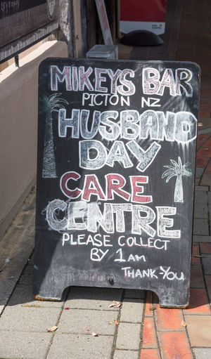 Picton,Marlborough,New Zealand-December 13,2016: Humorous chalkboard sign at Mikeys Bar on sidewalk in Picton, New Zealand Advertising Alphabet Funny Humor Art And Craft Bar Capital Letter Chalkboard Chalkboard Sign City Communication Creativity Food And Drink Establishment Footpath Information Information Sign Message Mikeys Bar New Zealand Picton  Sidewalk Sign Text Tourism Western Script