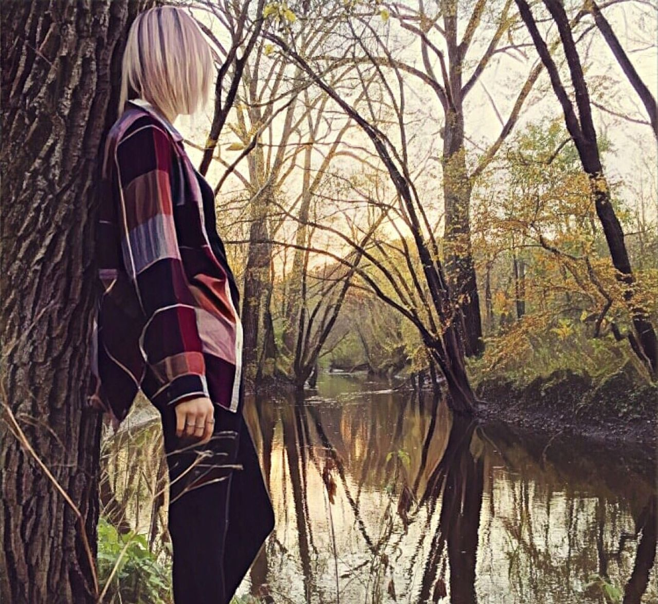 real people, tree, lifestyles, bare tree, one person, leisure activity, tree trunk, standing, outdoors, rear view, branch, casual clothing, day, water, nature, lake, forest, men, women, beauty in nature, sky, people