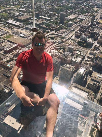 Chicago Skyline Chicago Chicago Skydeck! One Person Real People Young Men Casual Clothing Front View Leisure Activity Sitting Young Adult Full Length Lifestyles Sunglasses Day Glasses Sunlight Men Nature Three Quarter Length Looking At Camera Outdoors