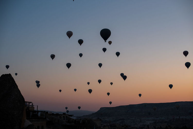 Cappadoccia views Adventure Air Vehicle Architecture Balloon Ballooning Festival Beauty In Nature Clear Sky Environment Flying Hot Air Balloon Mid-air Mountain Nature Outdoors Scenics - Nature Silhouette Sky Sunset Tourism Tranquility Transportation