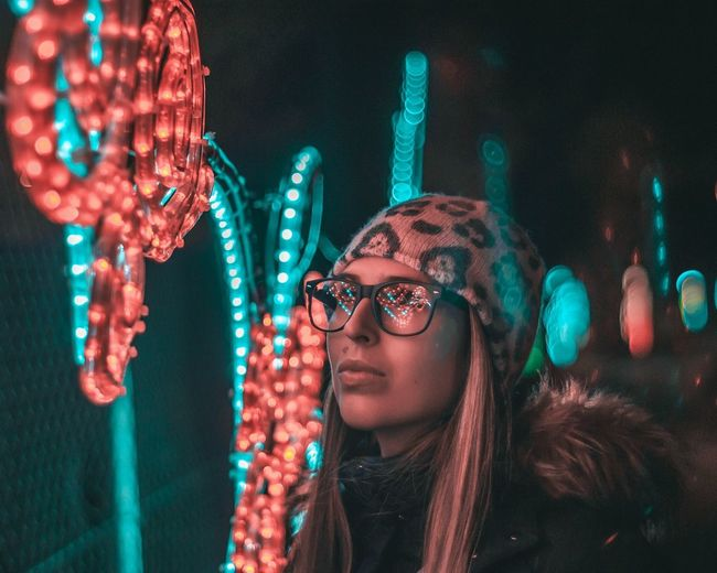 Lights And Shadows Lights In The City Lights At Night Portrait Of A Woman Warm Clothing Portrait Eyeglasses  Smiling Nightlife Happiness Illuminated Headshot Beautiful Woman Young Women Christmas Lights
