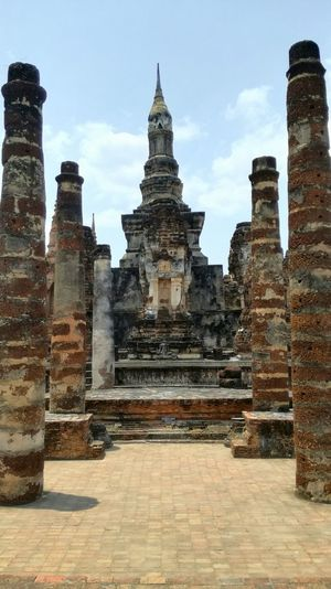 Buddha Place Of Worship Travel Destinations Religion Architecture Built Structure Travel Tourism Building Exterior Business Finance And Industry Sky Outdoors Day No People Sukothai Thailand