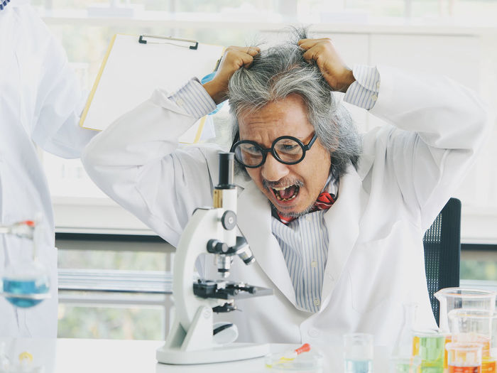 Healthcare And Medicine Science Eyeglasses  Glasses Research One Person Real People Laboratory Scientist Front View Lab Coat Men Indoors  Scientific Experiment Adult Education Occupation Males  Mature Adult Clothing Mature Men Medical Research