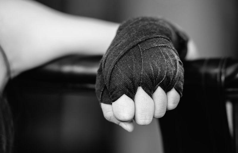 Cropped image of man wearing boxing glove
