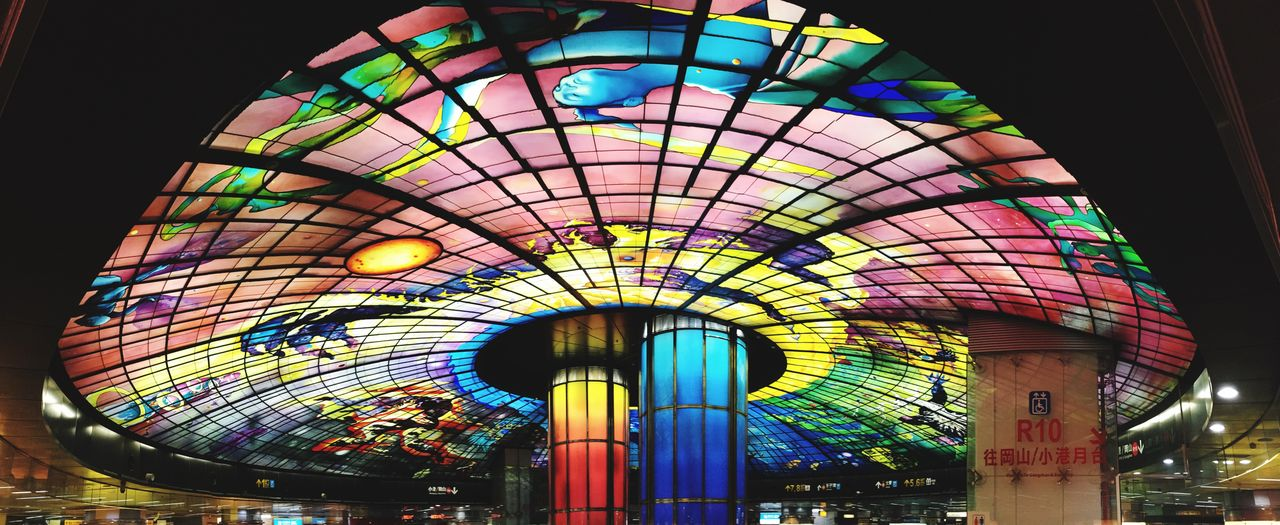 multi colored, illuminated, night, lighting equipment, amusement park ride, amusement park, architecture, low angle view, built structure, pattern, indoors, no people, arts culture and entertainment, ceiling, design, glowing, light, decoration, stained glass, architecture and art, luxury, ornate
