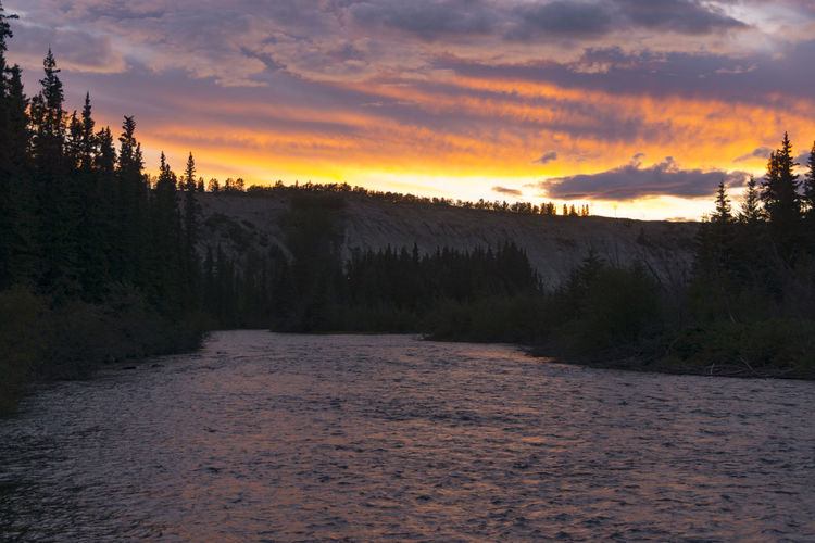 Sunset over the Yukon River, Whitehorse, Canada, August 2016 #clouds  #destination #river #sky #sunset #tourism #travel #whitehorse #yukon Beauty In Nature Cloud Dramatic Sky Landscape Moody Sky Nature No People Non-urban Scene Orange Color Outdoors Rippled Scenics Tranquil Scene Tranquility Water