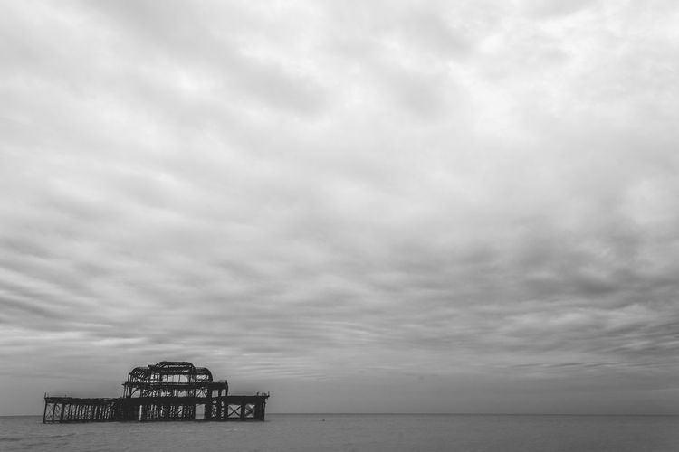 The Abandoned Pier - 3. Brighton, UK.Black And White Black And White Photography Brighton Calm Cloud - Sky Cloudy Horizon Over Water Landscape Minimalism Minimalism_bw Non-urban Scene Ocean Outdoors Pier Remote Sea Sea And Sky Seascape Sky My Year My View Tranquility Travel Travel Photography Water Feel The Journey Visual Creativity British Culture The Minimalist - 2019 EyeEm Awards