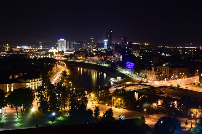 Vilnius at night Architecture Bridge Bridge - Man Made Structure Building Exterior Built Structure City City Life Cityscape Connection Engineering High Angle View Illuminated Night Outdoors River Road Sky Skyscraper Tourism Travel Travel Destinations Urban Skyline Vehicle Light Vilnius City Water