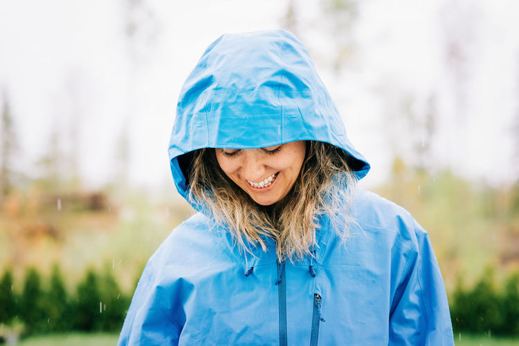 Portrait of a smiling young woman in rain