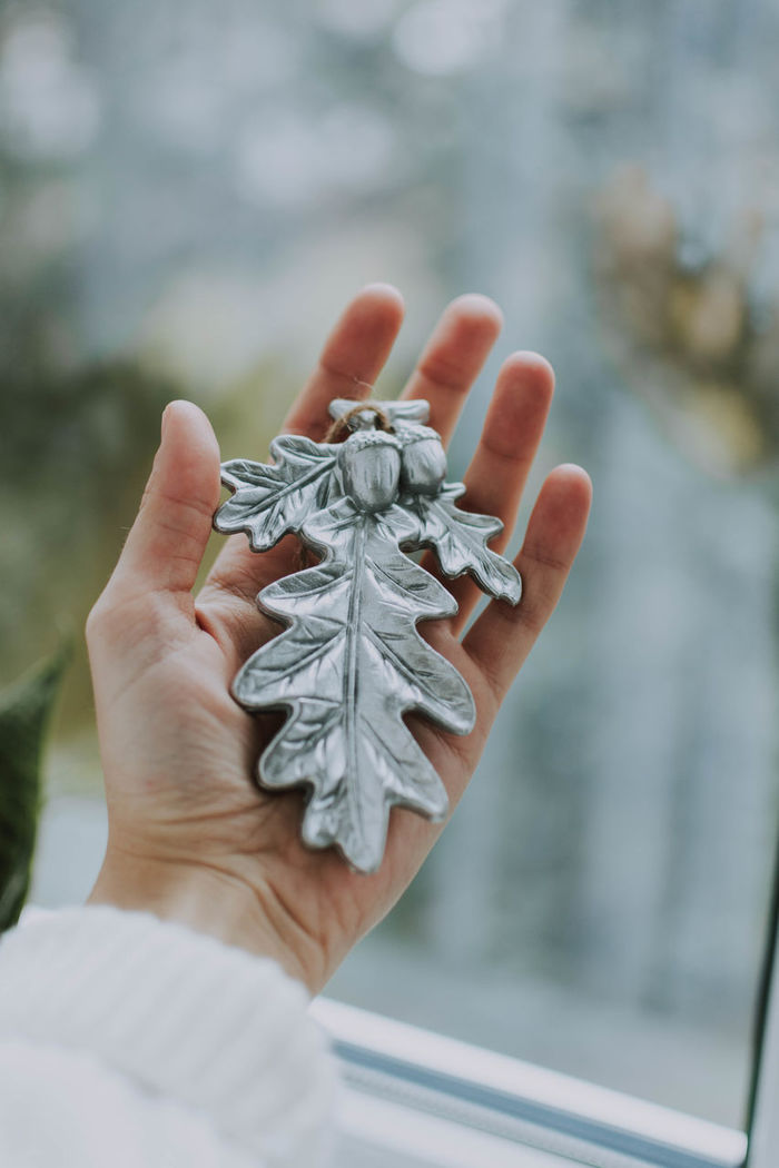 Cropped woman holding christmas decoration