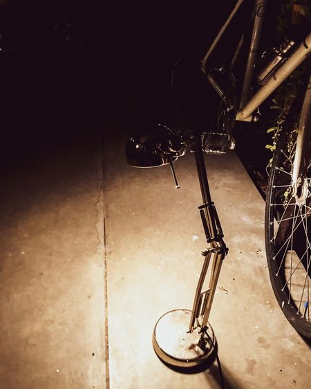 High angle view of bicycle parked against wall