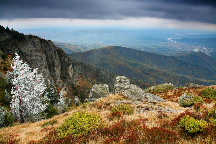 Scenic view of carpathian mountain range against cloudy sky