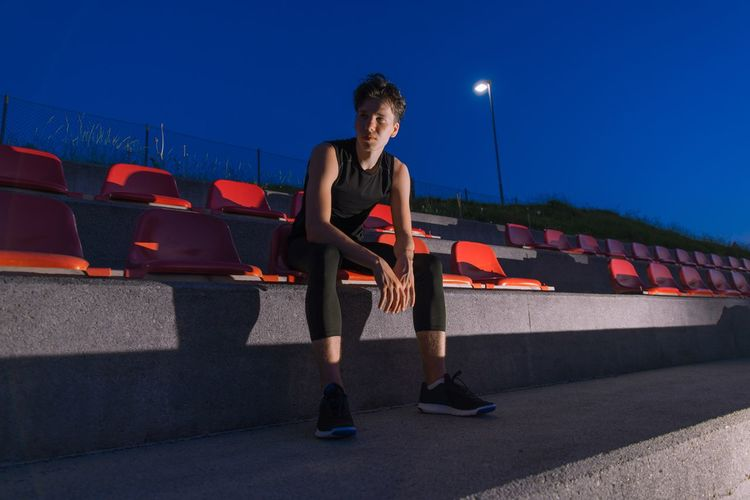 Athlet sitting in the stadium Training Sports Training Athletic Athlete Boy Running Player Playing Healthy Lifestyle Activity Boy Muscular Gym Runner Sport Arena Stadium Man One Person Night Adult Standing Lifestyles Leisure Activity Sport Real People