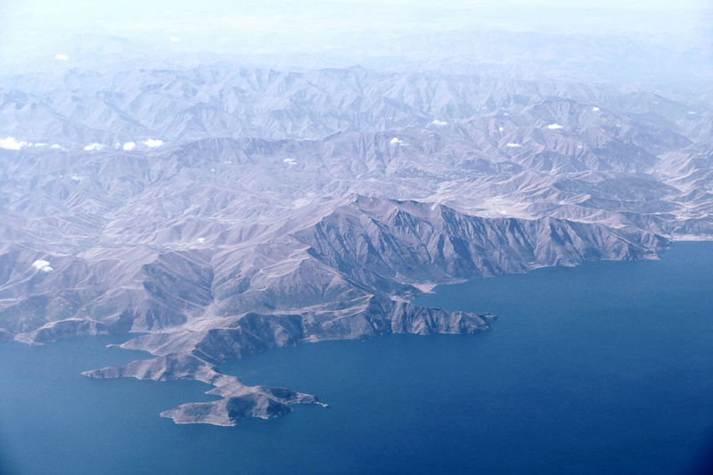 Aerial view of snowcapped mountains and lake