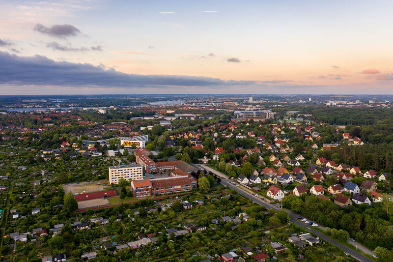 aerial view of the city of rostock Architecture Building Exterior Built Structure Sky Building Cloud - Sky Cityscape Residential District High Angle View Nature Sunset Aerial View Tree Community City TOWNSCAPE No People Plant Outdoors