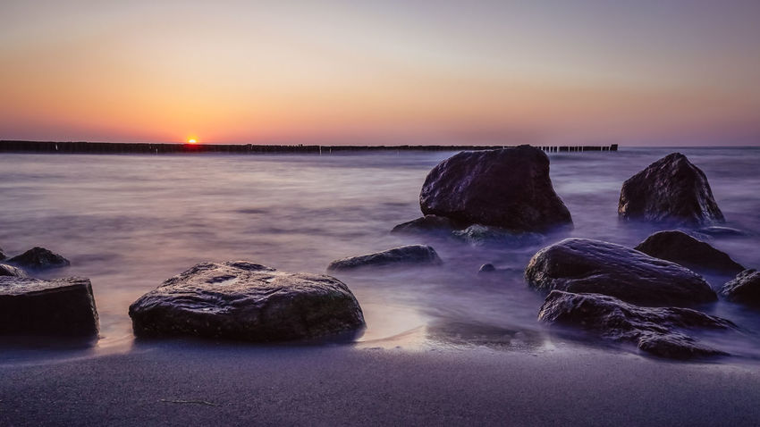 Sunset Stones at the Beach Baltic Sea Beach Beauty In Nature Dusk Horizon Horizon Over Water Land Long Exposure Motion Nature No People Outdoors Rock Rock - Object Scenics - Nature Sea Sky Solid Stones Sun Sunset Sunset #sun #clouds #skylovers #sky #nature #beautifulinnature #naturalbeauty #photography #landscape Tranquil Scene Tranquility Water