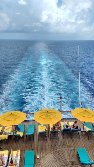 Cruise Ship Cruise Blue Blue Wave Wake Ocean Umbrellas Umbrella Yellow Umbrella Yellow Summer Ocean And Sky Sea Sea And Sky Intense Intense Colors Blue Sea Blue Sky Group Of People Cruise Ships Cruise Ship Photos Yellow Color Yellow Umbrela White Clouds Fluffy Clouds Let's Go. Together.